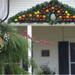 decoration on house with oranges, apples and greenery