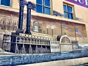 black smoke stacks on boat on mural
