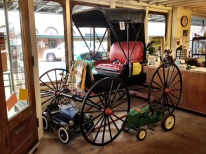 old horse drawn buggy in black and red