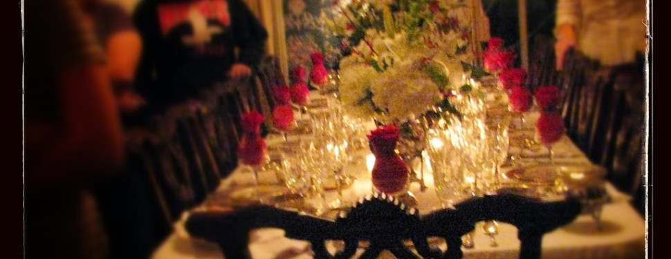 Christmas table decorated with crystal glasses on it
