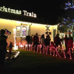 Christmas train depot decorated with lighted candy canes