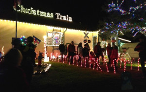 Christmas Train Depot decorated with lights outside.