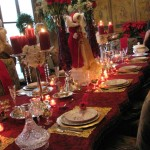 bright red table with candles burning for christmas