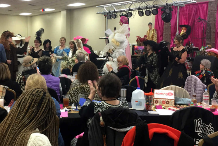 a room full of ladies with antique clothes on