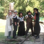 4 men and 1 woman dressed in western outfits