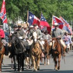 men and horses carrying flags