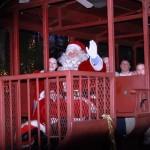 santa riding in a red train car
