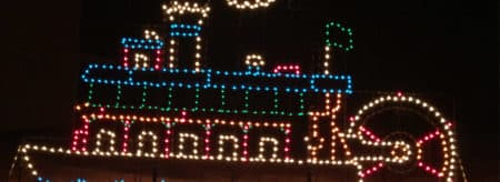 a steamboat metal frame with christmas lights